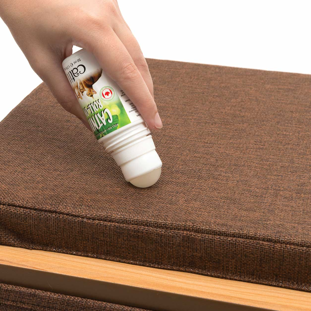 Catnip roller being used on furniture