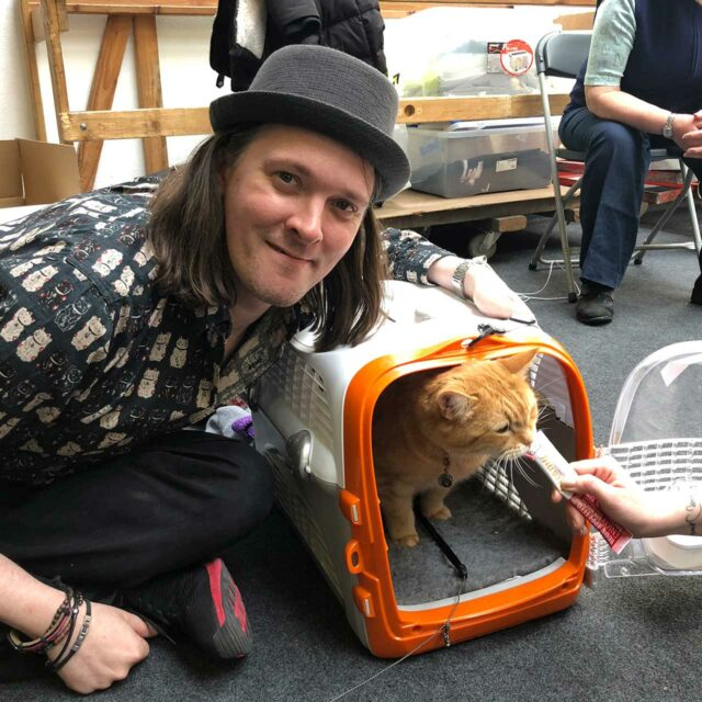 James Bowen with streetcat Bob sitting inside a Catit Cabrio Carrier